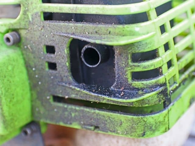 What causes a two-stroke engine to surge?
